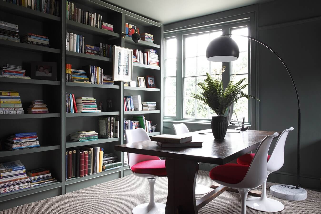 Study/library painted in Farrow and Ball Green Smoke, with tulip chairs by Eero Saarien