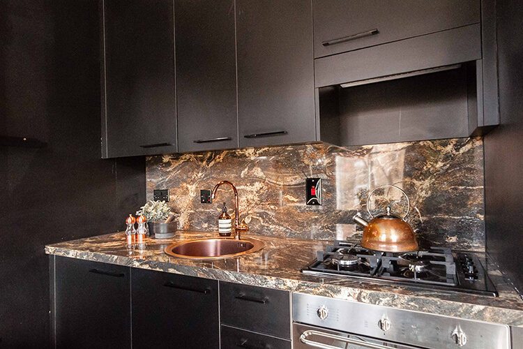 Black kitchen with marble