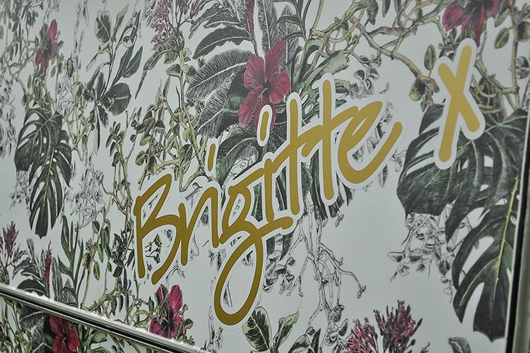 Tropical floral exterior of a vintage caravan