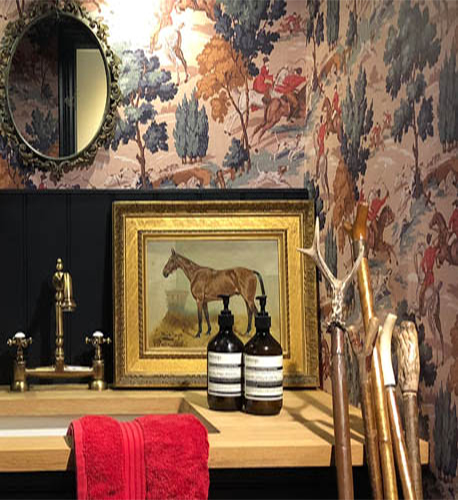 Country house cloakroom, hunting wallpaper